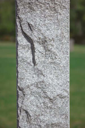 close up shot of stone memorial monument at cemetery