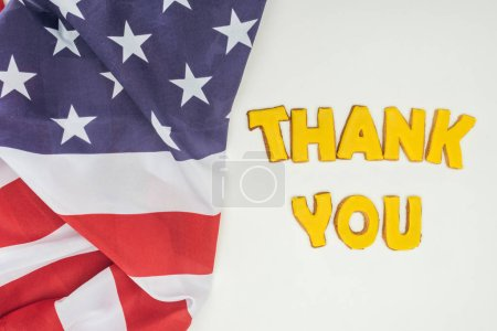 thank you lettering in in cookies with american flag isolated on white background