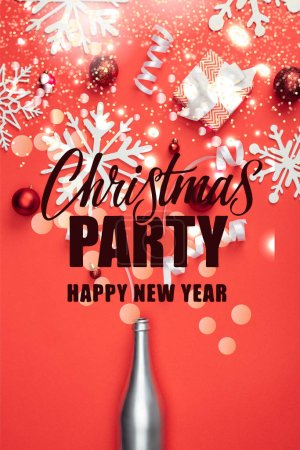 "Photo for Top view of present, champagne bottle, red christmas toys, white ribbons and decorative snowflakes arranged isolated on red with ""christmas party, happy new year"" lettering - Royalty Free Image"