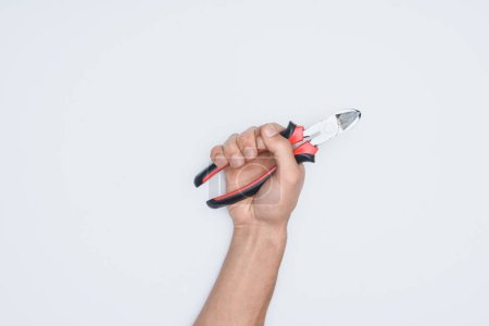 cropped shot of man holding pliers isolated on white