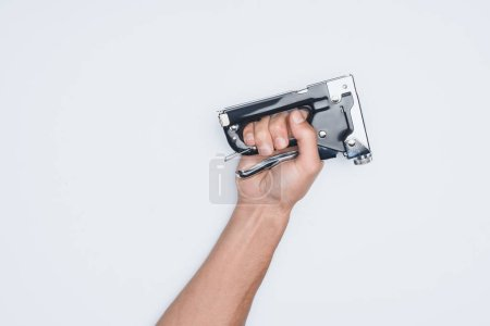 cropped shot of man holding stapler isolated on white