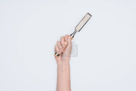 cropped shot of woman holding chisel isolated on white