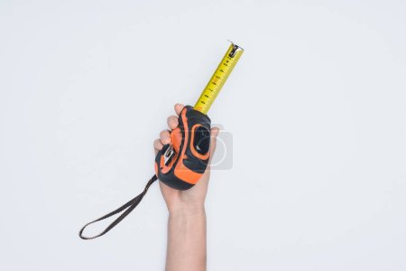 cropped shot of woman holding measuring tape tool isolated on white