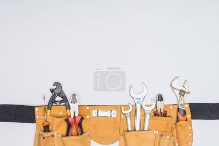 Photo for Top view of tool kit belt with repairman instruments isolated on white - Royalty Free Image