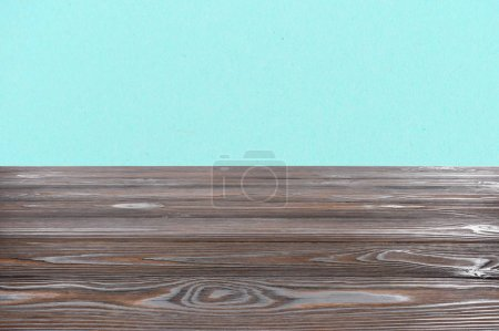 template of brown wooden floor on turquoise background