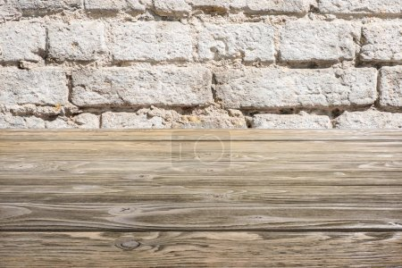 template of brown wooden floor with white wall on background