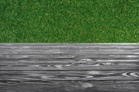 template of grey wooden floor with green grass on background