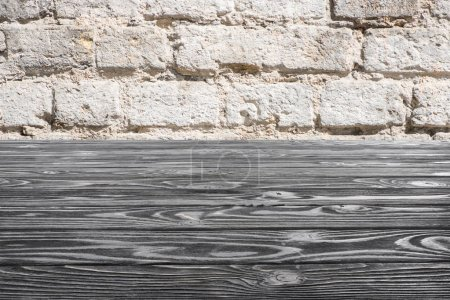template of grey wooden floor with white brick wall on background