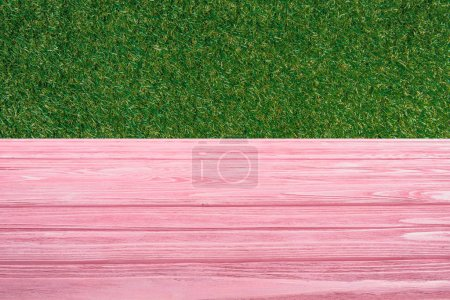 template of pink wooden floor with green grass on background