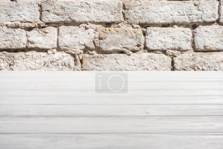 template of white wooden floor with brick wall on background