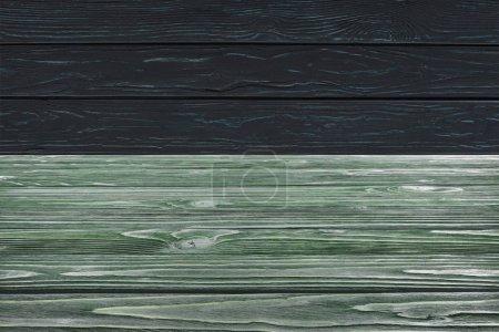 modèle de plancher de bois vert foncé sur fond noir de planches