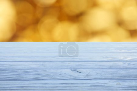 template of light blue wooden floor with blurred orange background