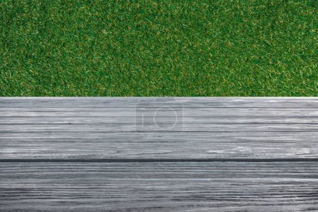 Photo for Template of grey wooden floor on green grass background - Royalty Free Image