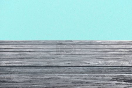 template of grey wooden floor on turquoise background