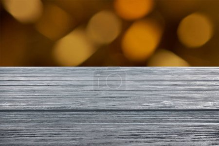 template of grey wooden floor with blurred orange background