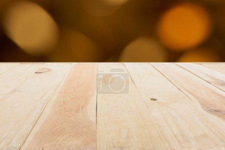 Photo for Template of beige wooden floor made of planks on blurred orange background - Royalty Free Image