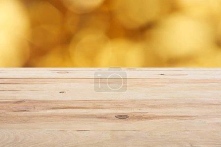 template of beige wooden floor on blurred golden background