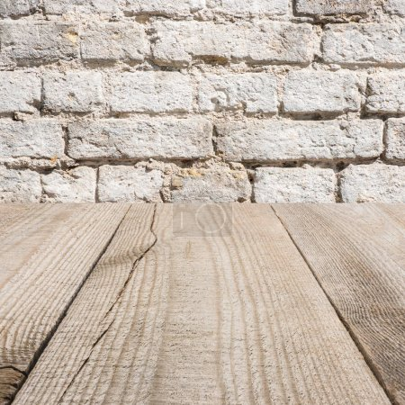 Photo for Surface of beige wooden planks with with brick wall on background - Royalty Free Image