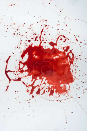 Photo for Top view of messy blood blot on white surface - Royalty Free Image
