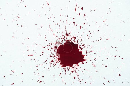 top view of blood splash with small droplets on white surface