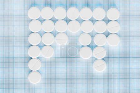 elevated view of arranged white pills on blue checkered surface