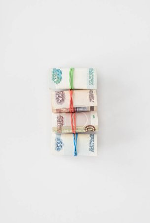 Photo for Flat lay with arranged various russian rolled banknotes placed in row on white surface - Royalty Free Image