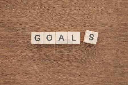Photo for 'goals' word made of wooden blocks on wooden tabletop, goal setting concept - Royalty Free Image