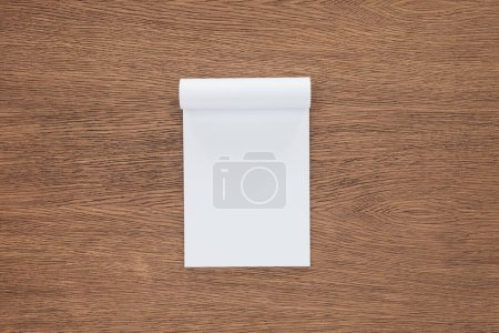 top view of blank notebook on wooden background