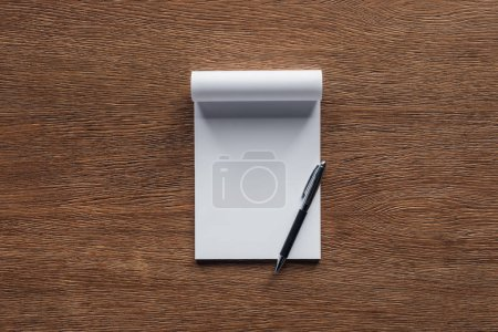 Photo for Blank notebook with pen on wooden background - Royalty Free Image