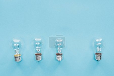 top view of three light bulbs in row and one aside, having new idea concept