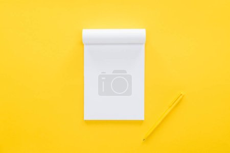 Photo for Top view of blank notebook on yellow background - Royalty Free Image