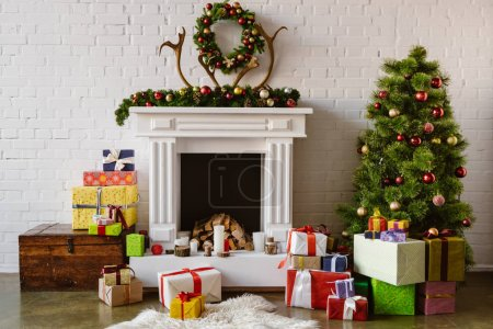 Photo for Festive living room with cozy fireplace, christmas tree and presents - Royalty Free Image