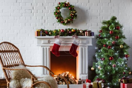 Photo for Living room with fireplace, rocking chair and decorated christmas tree - Royalty Free Image