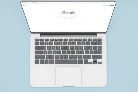 Photo for Top view of laptop with opened google browser isolated on light blue - Royalty Free Image