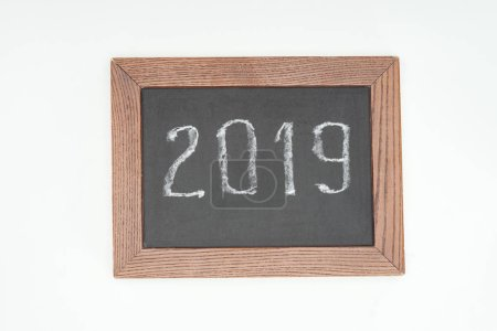 top view of 2019 date witten on chalk board isolated on white