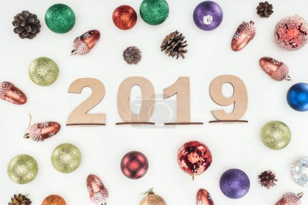 top view of 2019 date made of wooden numbers on background with christmas decorations isolated on white