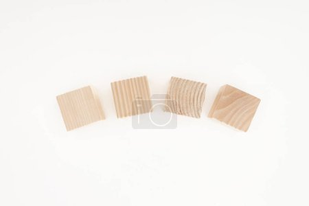 top view of four wooden blocks isolated on white