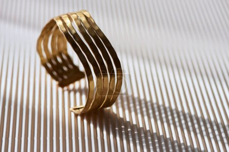 Photo for Close up of beautiful luxury ring on striped white surface with sunlight - Royalty Free Image