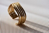 close up of beautiful luxury ring on striped white surface with sunlight
