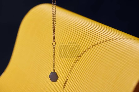 beautiful luxury necklace on yellow and black striped surface