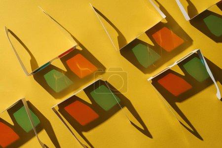 Photo pour Vue de dessus des lunettes 3d avec des ombres sur fond jaune - image libre de droit