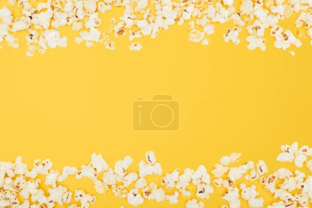 Photo for Horizontal frame made of fresh crunchy popcorn isolated on yellow - Royalty Free Image