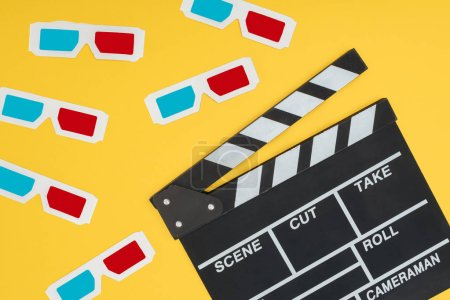 Photo for Plastic 3d glasses and clapperboard isolated on yellow - Royalty Free Image