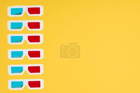 plastic 3d glasses in vertical row isolated on yellow