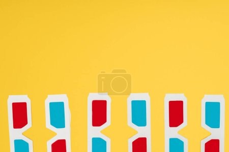 stereoscopic glasses in horizontal row isolated on yellow