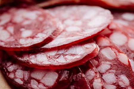 close up view of delicious fat sliced salami