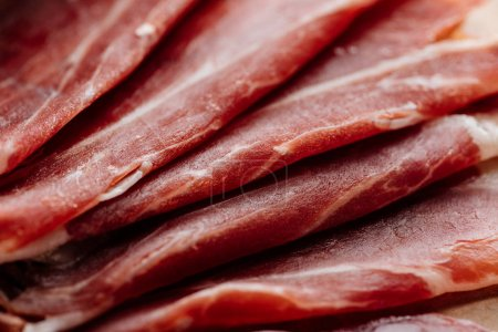 close up view of delicious thin sliced prosciutto