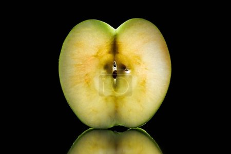 Photo for Half of raw ripe apple isolated on black - Royalty Free Image
