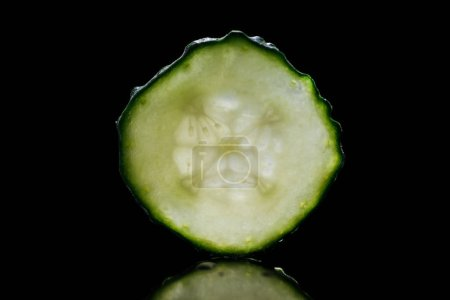 Photo for Slice of fresh ripe green cucumber isolated on black - Royalty Free Image