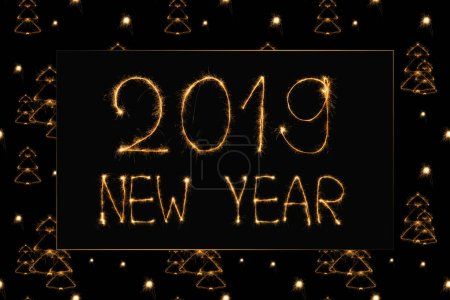 2019 new year light lettering and light fir tree signs on black background